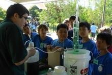 Devin Takara demonstrating bioenergy