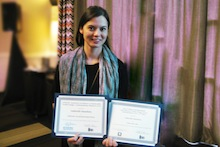 Gabrielle Sanehira with two awards