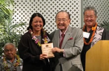 Jari Sugano accepting award and Farm Bureau convention