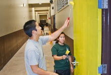 Rotaract club members painting door