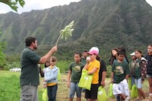 Ted Radovich with schoolchildren at the Waimanalo Research Station