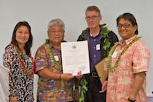 Brian Bushe is given certificate of appreciation