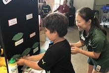 Andrea Kawabata with coffee leaf pest game