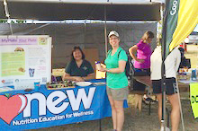 Dean Maria Gallo at NEW booth on Kaua'i