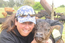 Marla Fergerstrom with a calf