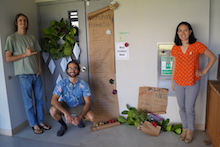 Alyssa Cho and grad students with Christmas door