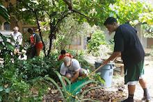 Volunteers raking the St. John Courtyard