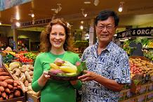 Dr. Watters and Dr. Huang show off local foods